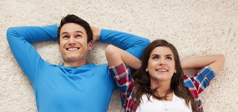 carpet couple smiling