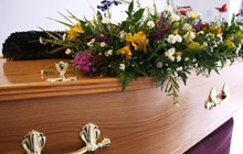 flowers and casket