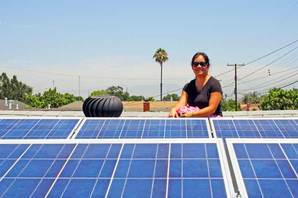 Homeowner Elizabeth Chey surveys her new solar panels, which should pay for themselves in 7 years. (Photo: YP/Justin McKinley)