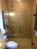 Custom curbless showers- no step. Glass shower door.