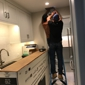 Ely Construction - Torrance, CA. Tracy and handyman on 1 ladder