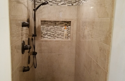 Performance Pro Plumbing Inc. Moen shower system in oil rubbed bronze finish