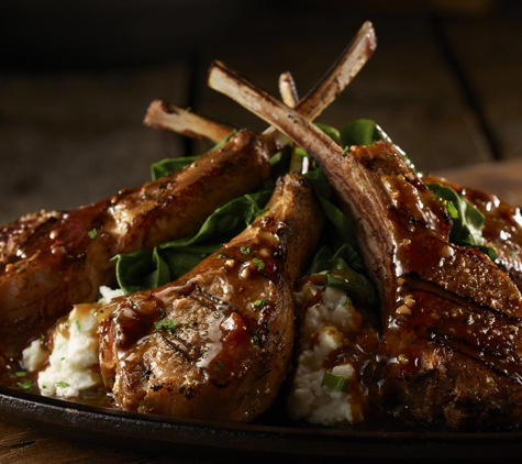 LongHorn Steakhouse. Come try our marinated bone-in lamb chops grilled over an open flame and finished with a roasted tomato garlic herb sauce.