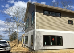 Taylor Forest Products Incorporated - Pembroke, MA. Allura Fibercement Siding on 2nd Floor, Primed Vertical CVG Red Cedar Siding on 1st Floor and  PVC Trimboards by Taylor Forest Products MA