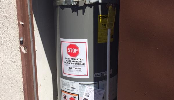 A Dan The Handyman - Santa Ana, CA. The new water heater ready installed.