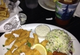Six Feet Under Pub & Fish House - Atlanta, GA. Catfish filets, hush puppies and coleslaw