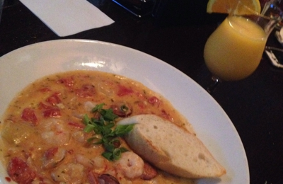 Front Page News - Atlanta, GA. Shrimp and grits brunch