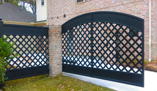 """Rio Grande Fence Co - Houston, TX. Rio Grande Fence - Houston Arched drive gate using 2"""" wide steel and sheet metal at top and bottom"""