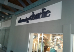 Corporate Signs - Doral, FL. illuminated black reverse channel letters with white LED lighting system