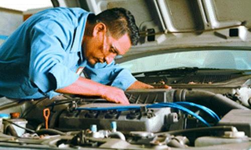 mechanic under hood-edit.jpg
