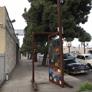 Victory Powder Coating & Sandblasting  Inc. - Los Angeles, CA. Tetris shapes falling in metal sliding door art installation at the corner of Broadway and 58th Street.