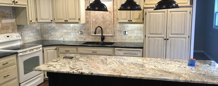 Kitchen cabinets went from oak to antique white with a glaze