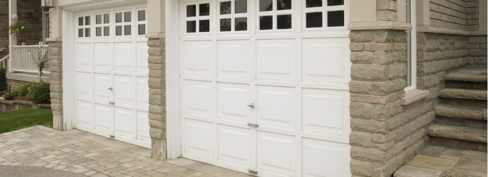 white garage door brick house