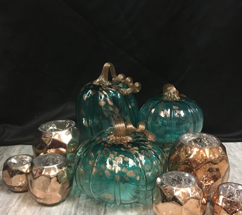 Andres' Day Spa & Gifts - Henrico, VA. Pumpkin and votives the perfect table setting