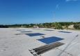 JT Roofing & Maintenance Inc. - Melbourne, FL. Replacing R-metal panels Ups Distribution center