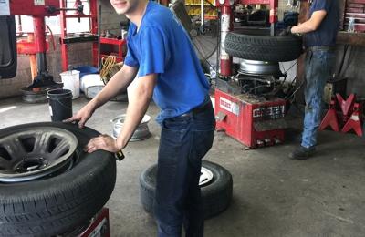 Economy Hi-Tread Tire Center - Scottsboro, AL. Mechanics, Terry and Jack, hard at work!