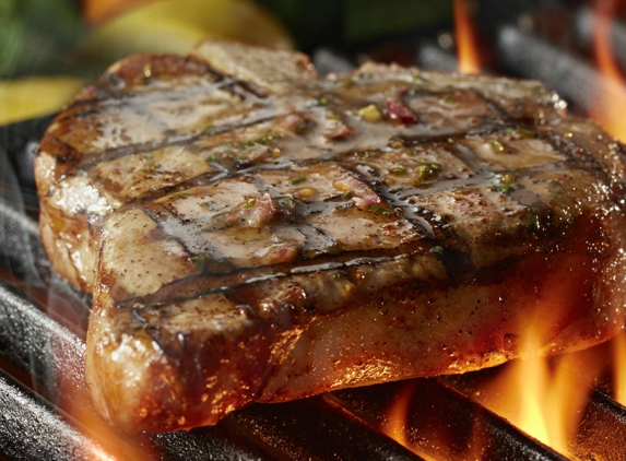 LongHorn Steakhouse. Try LongHorn's juicy bone-in pork porterhouse grilled over an open flame and topped with a housemade garlic-herb butter.