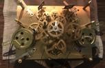 Gears inside a Kieniger movement.