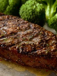 Our tender and marbled NY Strip, pepper-crusted and grilled over an open flame.