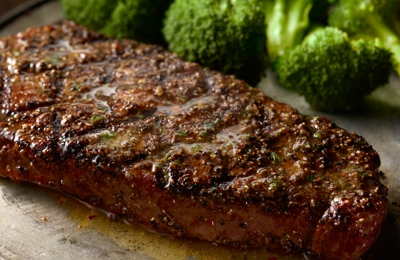Longhorn Steakhouse. Our tender and marbled NY Strip, pepper-crusted and grilled over an open flame.