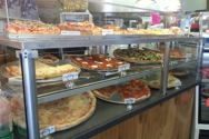 Some of the pizza sold by the slice or whole